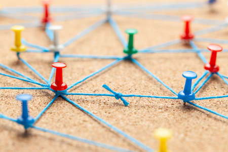 Business team. Connect between business people. Contract Arrangements. Office pins connected by blue and contract between the teams.