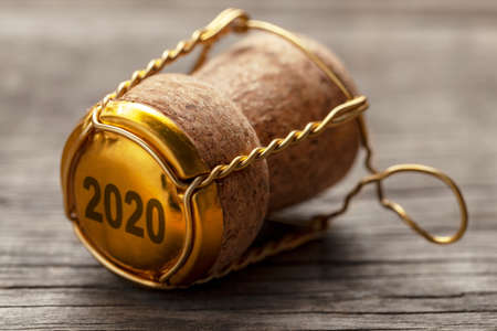 New Year 2020. Cork from champagne or wine on the old wooden table Stock Photo