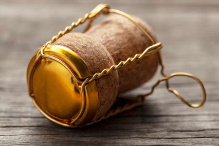 Cork from champagne or wine on the old wooden table