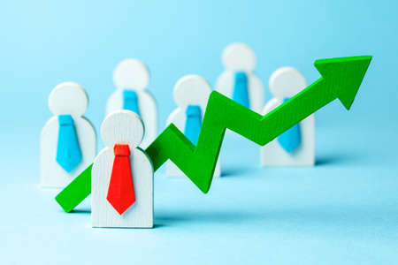 Many employees in ties and leader with an arrow up on blue background. Profit growth
