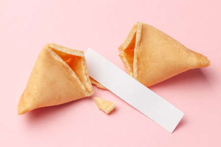 Chinese fortune cookies. Cookies with empty blank inside for prediction words. Pink background