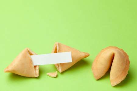 Chinese fortune cookies. Cookies with empty blank inside for prediction words. Green background Copy space for text Standard-Bild