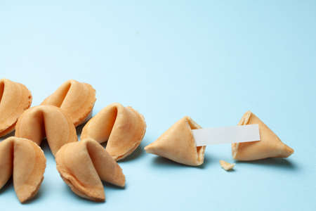 Chinese fortune cookies. Cookies with empty blank inside for prediction words. Blue background Copy space for text