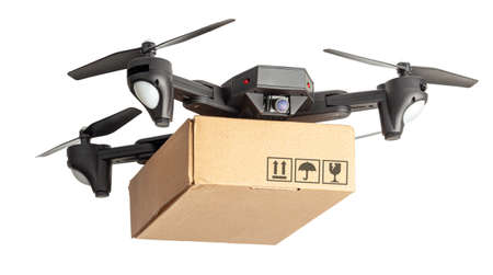 Drone with a cardboard box makes delivery by air. Drone with a camera carries postal parcel. Isolated on white background.