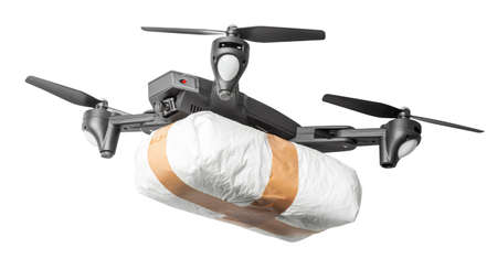 The drone flew across the sky with smuggling. The drone transports forbidden goods across the border breaking the law. Drug delivery  Isolated on white background.