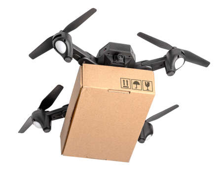 Drone with cardboard box makes delivery by air. Drone with camera carries postal parcel. Isolated on white background. 스톡 콘텐츠