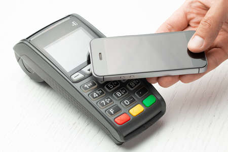 Contactless payment by smartphone phone. POS terminal NFC payment. Concept of how to choose payment method for shopping in a store