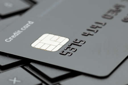 Black style. Credit card on a keyboard with a laptop. Online payment for purchases from online stores. Online shopping. 스톡 콘텐츠