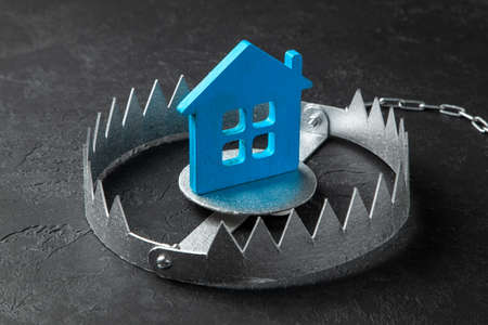 Trap with bait house. The risk of buying an old house. Dangerous mortgage. Home insurance. Black background