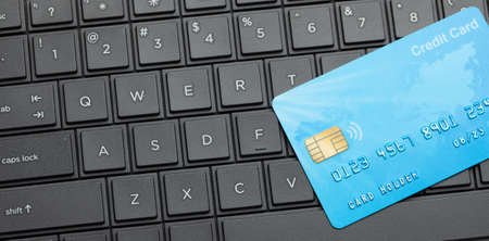 Credit card on keyboard with laptop. Online payment for purchases from online stores. Online shopping. Stok Fotoğraf