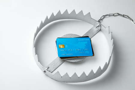 Trap with stack of credit cards. Unsafe credit risk. Gray background Reklamní fotografie