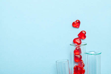 Hearts and test tube. Baby from tube vitro glass. Artificial insemination, IVF. Blue background. Copy space for text. Stok Fotoğraf