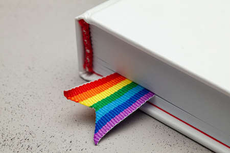 Book with bookmark and rainbow ribbon of LGBT pride. 版權商用圖片