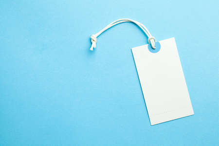 Tags for the price and labels for clothes. White tag mock-up on a blue background. Copy space for text