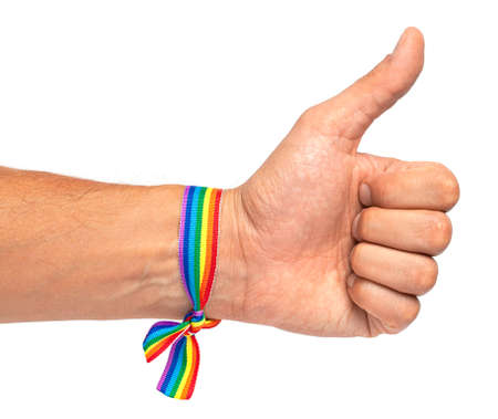 Thumbs up. LGBT rainbow ribbon on male hand. isolated on white