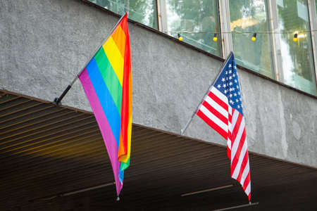 Flags of America and the LGBT community on the building. Sexual minorities in USA Banco de Imagens