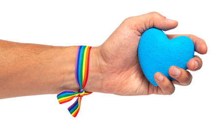 Man holds a heart in his hand. Rainbow ribbon LGBT pride. Gay with blue heart. Isolated on a white background.