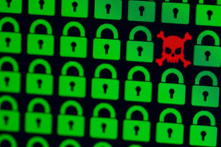 Skull and bone as a symbol of hacking programs or personal information and data. Cyber crime. Green pixel padlock lock and a red skull with bones on a black background, close-up.