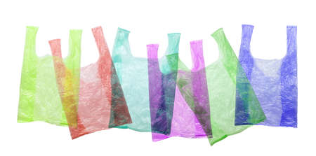 Colored plastic bags isolated against a white background. Environmental pollution by disposable bags, recycling.