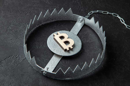 Bitcoin sign in a trap. Cryptocurrency is a trap for money.