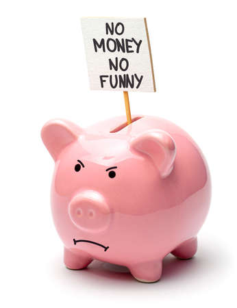No money, no funny. Pink piggy bank with a poster isolated on a white background. Evil pig face.