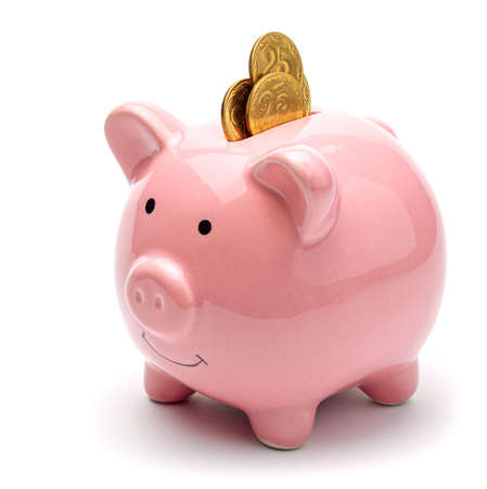 Pink piggy bank full of gold coins isolated on a white background. Concept of where to invest your savings