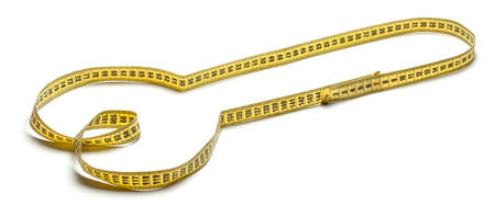Penis from a yellow measuring tape isolated on a white background. Measurement of the male genital organ