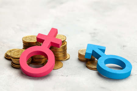 Discrimination of men. A large stack of coins and a gender symbol of a woman and a small stack of coins and a gender symbol of a man. Salary discrimination