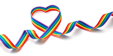 Rainbow ribbon in the shape of heart. Pride tape symbol. Isolated on a white background