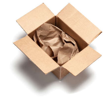 Open cardboard box with wrapping paper inside. Isolated on a white background. Top view. mock-up. Stock Photo