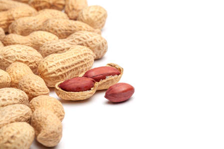 Dried peanuts in peel closeup isolated on white background Stock Photo