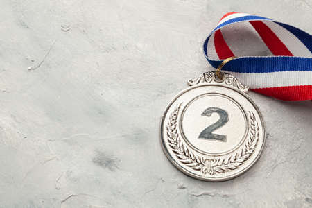 Silver medal. Second place award with ribbon