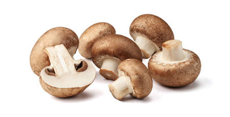 Two fresh mushrooms champignons, one whole and the other cut in half isolated on white background Фото со стока