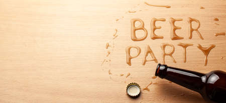 Beer party. A bottle of beer and a spilled drink. Copy space for text.