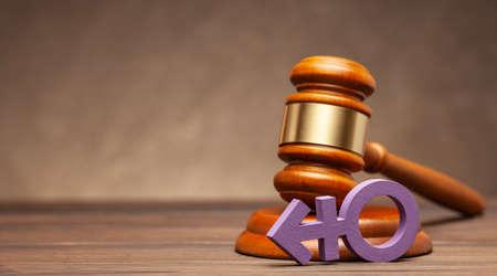 Transgender symbol and judge gavel on brown background
