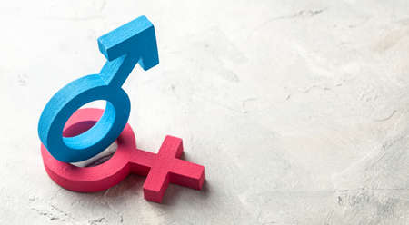 Gender symbols of man and woman on a gray background