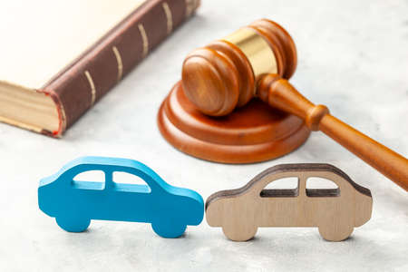 Car accident. Judge gavel and two cars collided. Car Insurance Solution