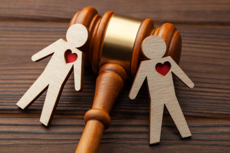 Judge gavel and the figure of two gay guys holding hands Stock Photo