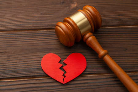 Divorce and division of property. Broken heart and judge gavel Stock Photo