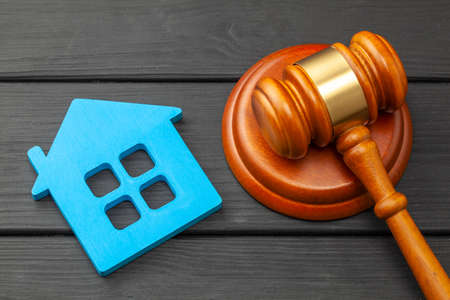Home after divorce. Property section. Judge gavel and house. Buying or selling a home