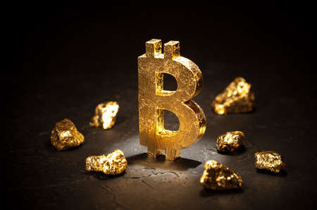 Gold sign bitcoin and gold nuggets on black background Stock Photo