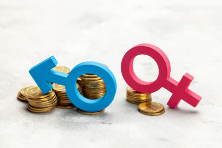 Discrimination of women. A large stack of coins and a gender symbol of a man and a small stack of coins and a gender symbol of a woman. Salary discrimination