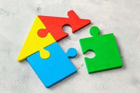 House puzzle Home loan. Parts of the house are brought together Stock Photo