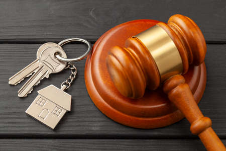 Home after divorce. Property section. Judge gavel and house keys. Buying or selling a home through auction Stock Photo