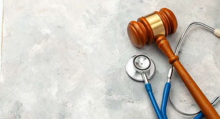 Judge gavel and stethoscope. The law in medicine, the sentence on medical negligence
