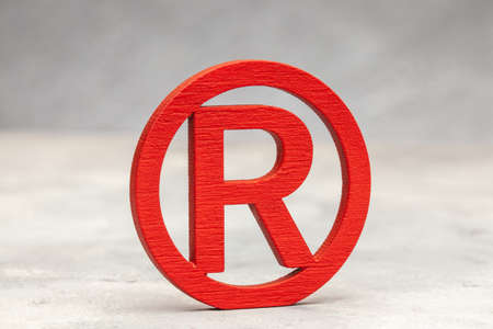 Red wood trademark sign on gray background Stock Photo