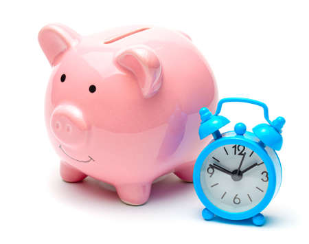 Time is money. Piggy bank and clock with an alarm clock. Isolated on a white background Stock Photo