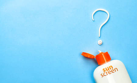 Sunscreen. Cream in the form of question mark on blue background with white tube. Concept of how to choose sunblock