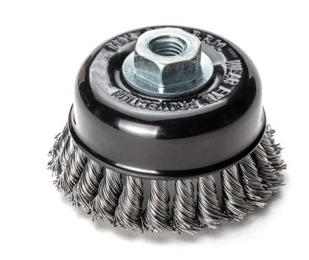 Metal brush for cleaning metal. solated on white