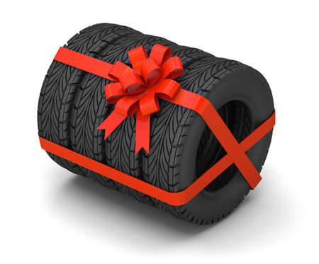 Tires as a gift. A set of four tires with a red gift ribbon with a bow. isolated on white background. 3d render 免版税图像